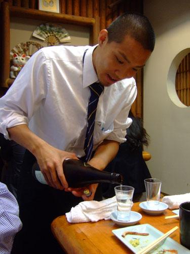 Pouring Hakkaisan Junmai-Ginjo Sake